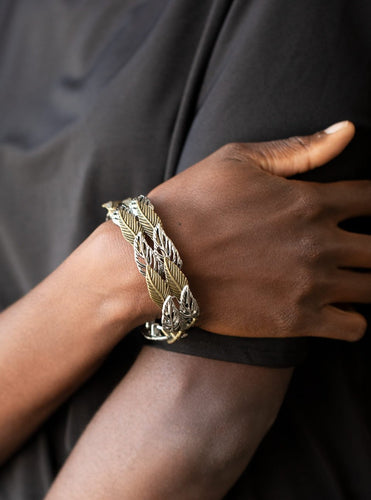 Featuring life-like textures, pairs of brass and silver feather charms are threaded along stretchy bands as they overlap around the wrist for a whimsical look.  Sold as one individual bracelet.  Always nickel and lead free.