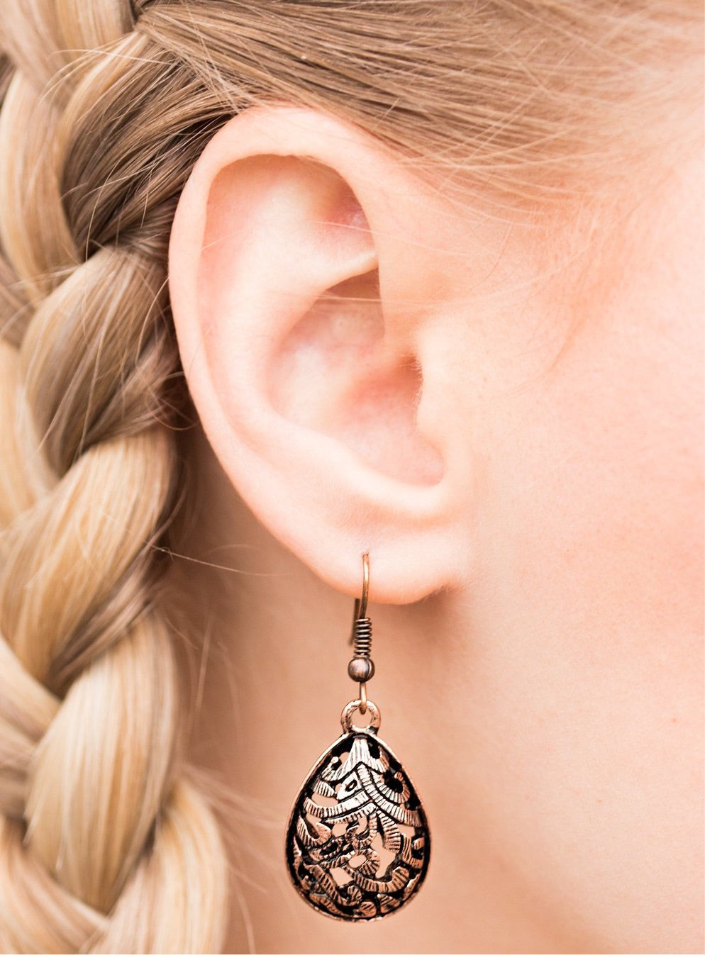 Etched in shimmer, copper vine-like filigree climbs a copper teardrop for a tribal inspired look. Earring attaches to a standard fishhook fitting.  Sold as one pair of earrings.  Always nickel and lead free.