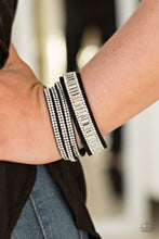 Load image into Gallery viewer, Encrusted in mismatched sparkle, half of a black suede band is encrusted in white emerald style cut rhinestones, while the other half splits into three separate bands encrusted in white rhinestones for a sassy look. The elongated band allows for a trendy double wrap design. Features an adjustable snap closure.  Sold as one individual bracelet.  Always nickel and lead free.