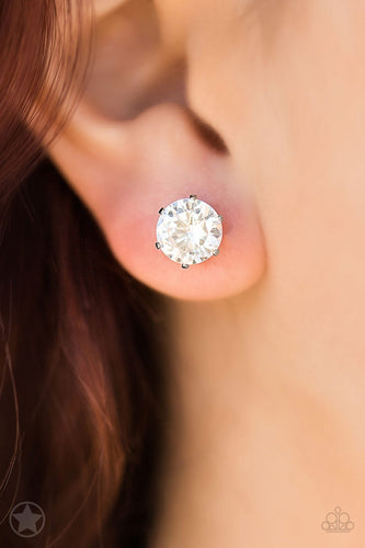 A sparkling white rhinestone is nestled inside a classic silver frame for a timeless look. Earring attaches to a standard post fitting.  Sold as one pair of post earrings.  Always nickel and lead free.
