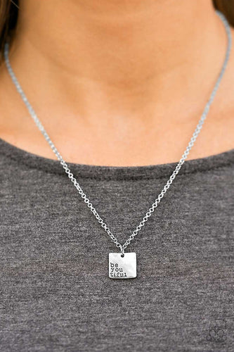 "The phrase, ""be you tiful"" adorns the corner of a shiny silver square, creating an inspiring minimalistic design. Features an adjustable clasp closure.  Sold as one individual necklace. Includes one pair of matching earrings.  Always nickel and lead free."