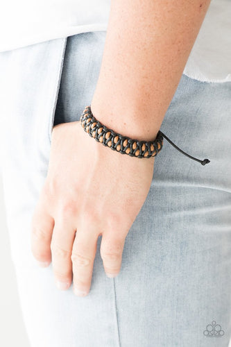 Shiny black and brown cording weaves together, creating a knotted braid across the wrist. Features an adjustable sliding knot closure.  Sold as one individual bracelet.  Always nickel and lead free.