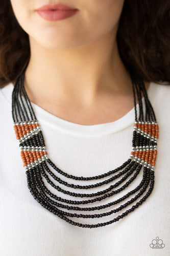 Separated by shimmery silver fittings, black, brown, and silver seed beaded geometric frames give way to layers of black seed beads down the chest for a tribal inspired flair. Features an adjustable clasp closure.  Sold as one individual necklace and earring set.  Always nickel and lead free!