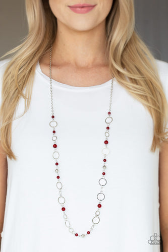 Shimmery silver hoops and glowing red moonstone beads connect into a whimsical chain across the chest. Features an adjustable clasp closure.  Sold as one individual necklace. Includes one pair of matching earrings.  Always nickel and lead free!