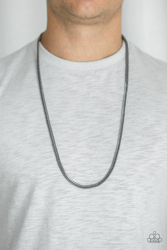 Brushed in a high-sheen finish, a shimmery row of gunmetal flat franco chain drapes across the chest for a casual shine. Features an adjustable clasp closure.  Sold as one individual necklace.  Always nickel and lead free.