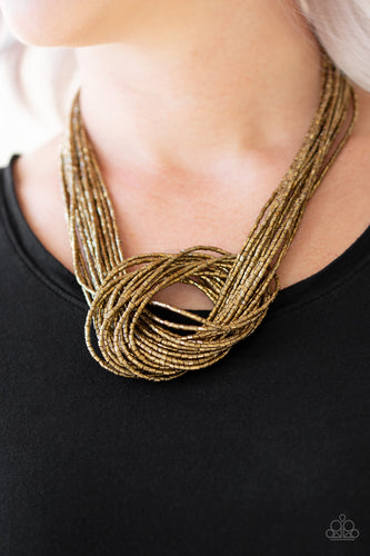 Countless strands of brass seed beads delicately knot together below the collar to create an unforgettable statement piece. Features an adjustable clasp closure.  Sold as one individual necklace. Includes one pair of matching earrings.  Always nickel and lead free.