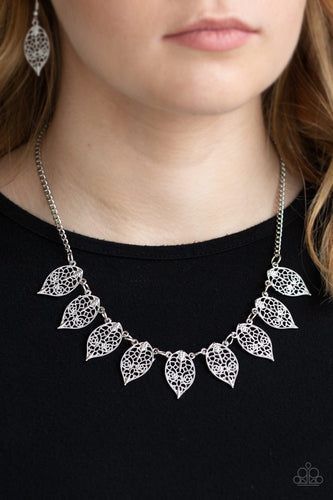 Swirling with dotted filigree, dainty silver leaf frames swing from the bottom of a glistening silver chain, creating a whimsical fringe below the collar. Features an adjustable clasp closure.  Sold as one individual necklace. Includes one pair of matching earrings.  Always nickel and lead free.
