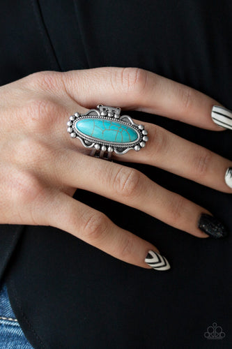 An oblong turquoise stone is pressed into the center of an ornate silver frame for a seasonal look. Features a stretchy band for a flexible fit.  Sold as one individual ring.