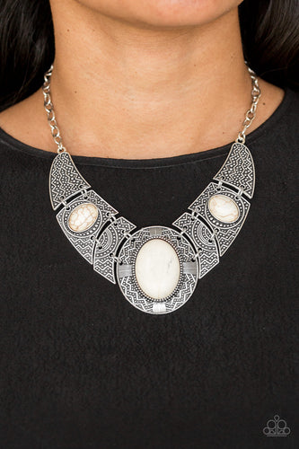 Gradually increasing in size, dramatically oversized smoky gems are pressed into the centers of hammered and silver studded frames. The blinding frames link below the collar for a glamorous, statement-making finish. Features an adjustable clasp closure.  Sold as one individual necklace. Includes one pair of matching earrings.   Always nickel and lead free.