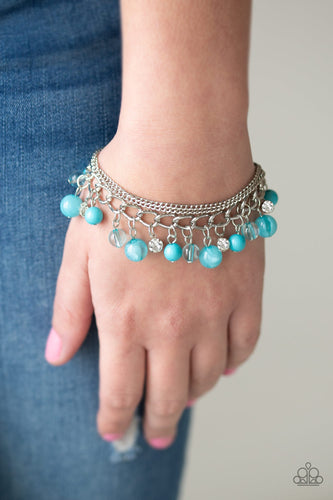 Infused with layers of mismatched silver chains, glassy, polished blue, and glittery white rhinestones swing from the wrist in a whimsical fashion. Features an adjustable clasp closure.  Sold as one individual bracelet.  Always nickel and lead free.