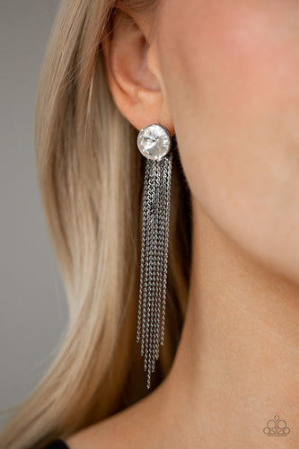 Flat gunmetal chains stream from the bottom of a solitaire white gem, creating a dramatically tapered fringe. Earring attaches to a standard post fitting.  Sold as one pair of post earrings.   Always nickel and lead free.