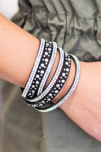 Bubbly silver studs, and rows of glittery white rhinestones are encrusted along strips of black suede. The elongated design allows for a trendy double wrap around the wrist. Features an adjustable snap closure.  Sold as one individual bracelet.  Always nickel and lead free.