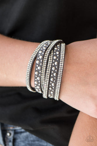 Bubbly silver studs, and rows of glittery white rhinestones are encrusted along strips of gray suede. The elongated design allows for a trendy double wrap around the wrist. Features an adjustable snap closure.  Sold as one individual bracelet.  Always nickel and lead free.