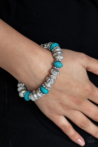 A collection of faceted blue beads, ornate silver beads, and studded silver rings are threaded along a stretchy band around the wrist for a colorfully refined look.  Sold as one individual bracelet.  Always nickel and lead free.