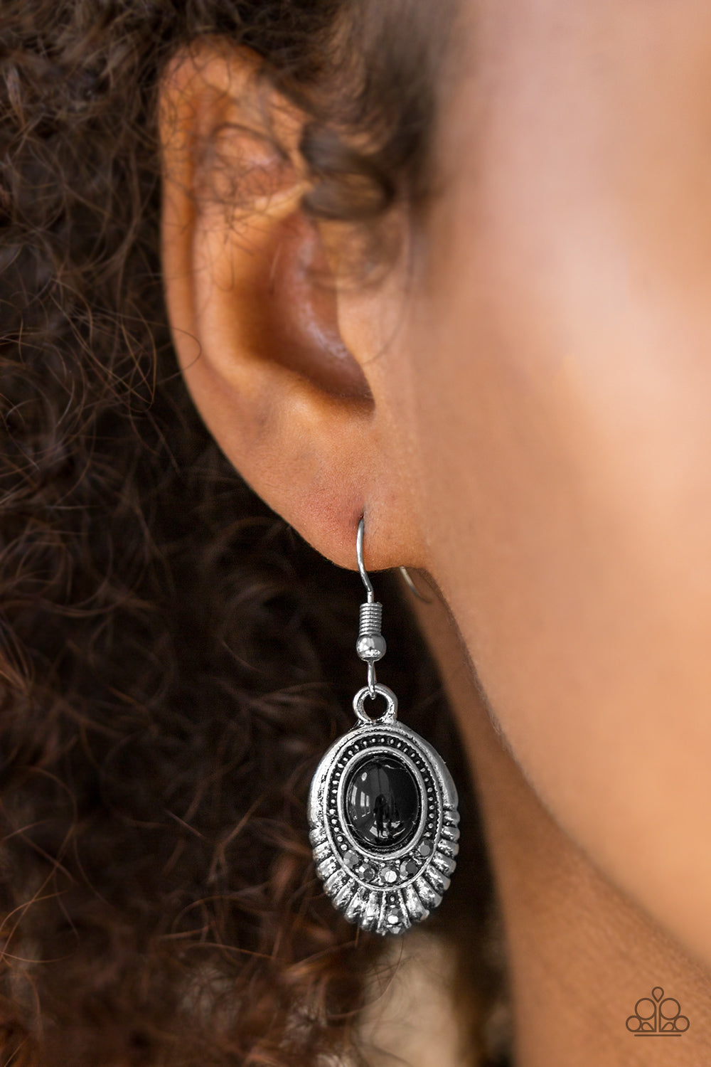 A shiny black bead is pressed into the center of an ornate silver frame. Glittery hematite rhinestones are sprinkled along the textured frame, adding a refined shimmer to the seasonal palette. Earring attaches to a standard fishhook fitting.  Sold as one pair of earrings.  Always nickel and lead free.