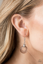 Load image into Gallery viewer, Chiseled into an alluring hoop, a glistening  moonstone swings from the bottom of a silver fitting, creating a whimsical glow. Earring attaches to a standard fishhook fitting.  Sold as one pair of earrings.  Always nickel and lead free.