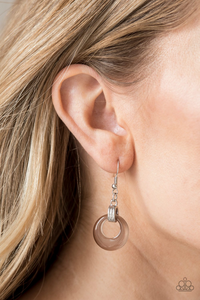 Chiseled into an alluring hoop, a glistening  moonstone swings from the bottom of a silver fitting, creating a whimsical glow. Earring attaches to a standard fishhook fitting.  Sold as one pair of earrings.  Always nickel and lead free.