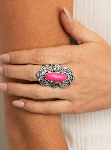 Embossed in lotus, sunset, and bold tribal inspired details, a scalloped silver frame nestles around a vivacious pink stone center for a colorful seasonal flair. Features a stretchy band for a flexible fit.  Sold as one individual ring.  Always nickel and lead free
