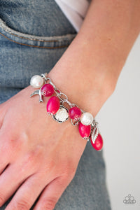 Gorgeous pearls, shiny pink beading, and a collection of shiny silver charms, including a bird and a feather, dance around the wrist in a whimsical fashion. Features an adjustable clasp closure.  Sold as one individual bracelet.  Always nickel and lead free.