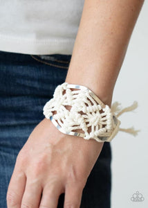 White cording decoratively knots and weaves around an airy silver cuff for a macramé inspired look. Knotted around the ends, white tassels flair out from bottoms of the cuff for a wanderlust finish.  Sold as one individual.  Always nickel and lead free.  Life of the Party September 2020