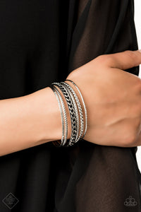 Featuring an array of chain-like and tribal inspired patterns, a collection of mismatched silver bangles slides up and down the wrist for an edgy look.  Sold as one set of six bracelets.