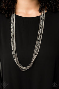 A chaotic mix of popcorn, classic, and dainty chains stream down the chest in an industrial masterpiece. The alternating finishes of shiny silver and glistening gunmetal adds miles of attitude to the design, resulting in an edgy collision of mixed metallic shimmer. Features an adjustable clasp closure.
