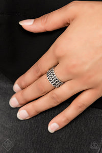 Three row of shimmery silver chains links stack across the finger, coalescing into an edgy layered band. Features a stretchy band for a flexible fit.