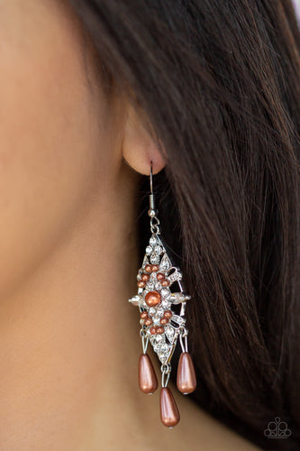 Dotted with dainty brown pearls, a silver kite-shaped frame is encrusted in glassy white rhinestones. Teardrop pearls swing from the bottom of the sparkling frame for a refined flair. Earring attaches to a standard fishhook fitting.  Sold as one pair of earrings. Always nickel and lead free.