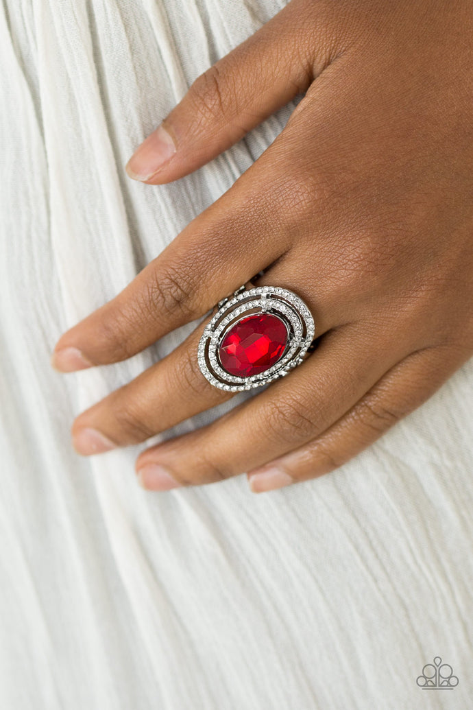 A glittery red gem sits atop stacked silver frames radiating with glassy white rhinestones for a timeless look. Features a stretchy band for a flexible fit.  Sold as one individual ring.