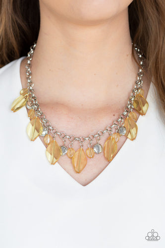 A collection of glassy yellow beads and shimmery silver accents dangle from the bottom of a glistening silver chain, creating a flirtatious fringe below the collar. Features an adjustable clasp closure.  Sold as one individual necklace. Includes one pair of matching earrings.  Always nickel and lead free.