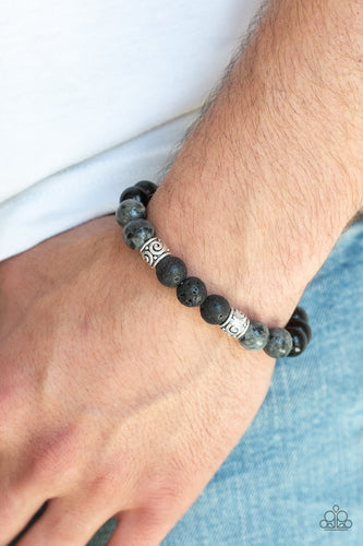Infused with ornate silver beads, a collection of polished black beads, black lava rock beads, and brown stone beads are threaded along a stretchy band around the wrist for a seasonal look.  Sold as one individual bracelet.  Always nickel and lead free.