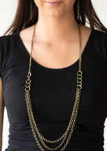 Load image into Gallery viewer, Bold brass chain links give way to layers of mismatched brass chain, creating a dramatic industrial collision. Features an adjustable clasp closure.  Sold as one individual necklace. Includes one pair of matching earrings.  Always nickel and lead free.