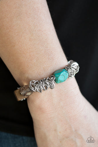 A mishmash of bold silver chain, refreshing turquoise stones, a square wooden bead and metallic and crystal-like accents are threaded along a stretchy elastic band for a seasonal look.  Sold as one individual bracelet.  Always nickel and lead free.