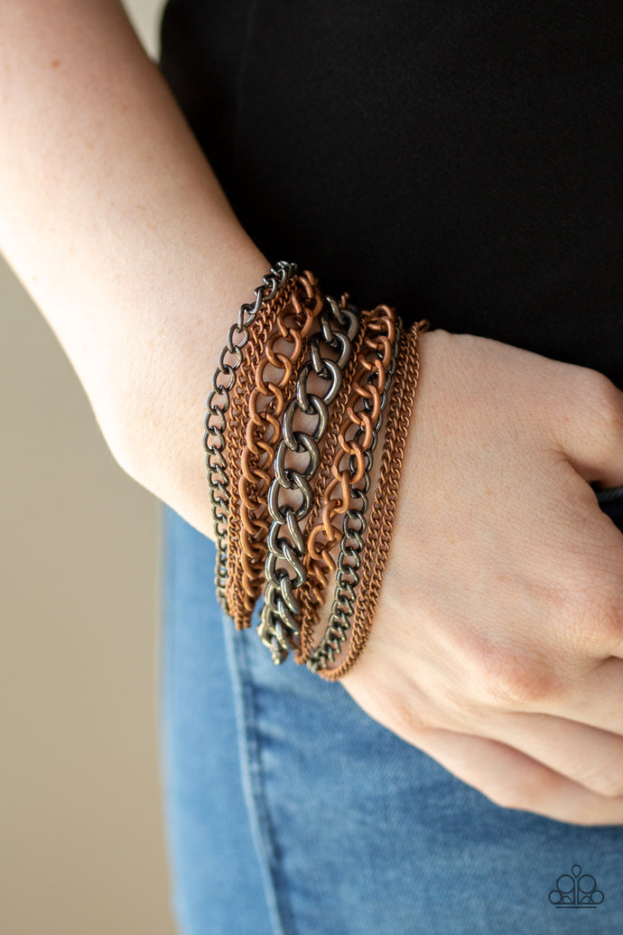 An assortment of mismatched copper and gunmetal chains have been strung between two hammered copper fittings, creating edgy layers around the wrist. Features an adjustable clasp closure.  Sold as one individual bracelet.  Always nickel and lead free.