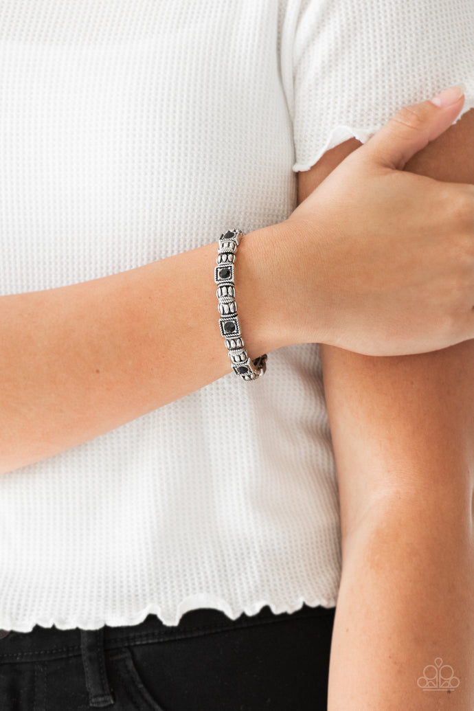 Infused with black rhinestone centers, ornate silver frames are threaded along stretchy bands, creating a refined look around the wrist.  Sold as one individual bracelet.   Always nickel and lead free.