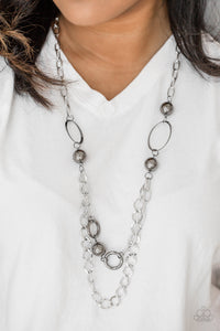 Dramatic gunmetal accents trickle along bold silver chains, creating an edgy mixed metallic palette across the chest. Features an adjustable clasp closure.  Sold as one individual necklace. Includes one pair of matching earrings.  Always nickel and lead free.
