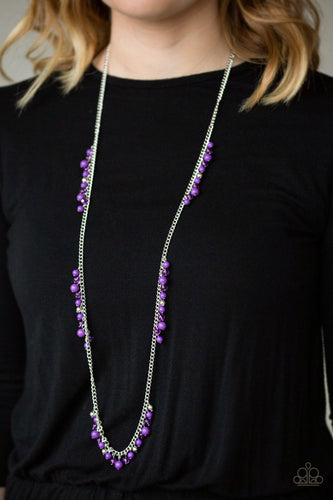 Sections of shiny silver, polished purple, and glassy beads trickle along a shimmery silver chain along the chest for a flirtatious look. Features an adjustable clasp closure.  Sold as one individual necklace. Includes one pair of matching earrings.  Always nickel and lead free.  Item #P2WH-PRXX-357XX