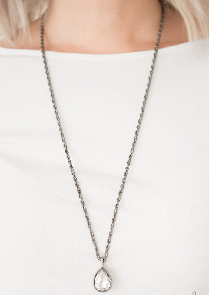 A white teardrop gem is pressed into a sleek gunmetal frame, creating a bold 3-dimensional pendant below the collar. Features an adjustable clasp closure.  Sold as one individual necklace. Includes one pair of matching earrings.  Always nickel and lead free.