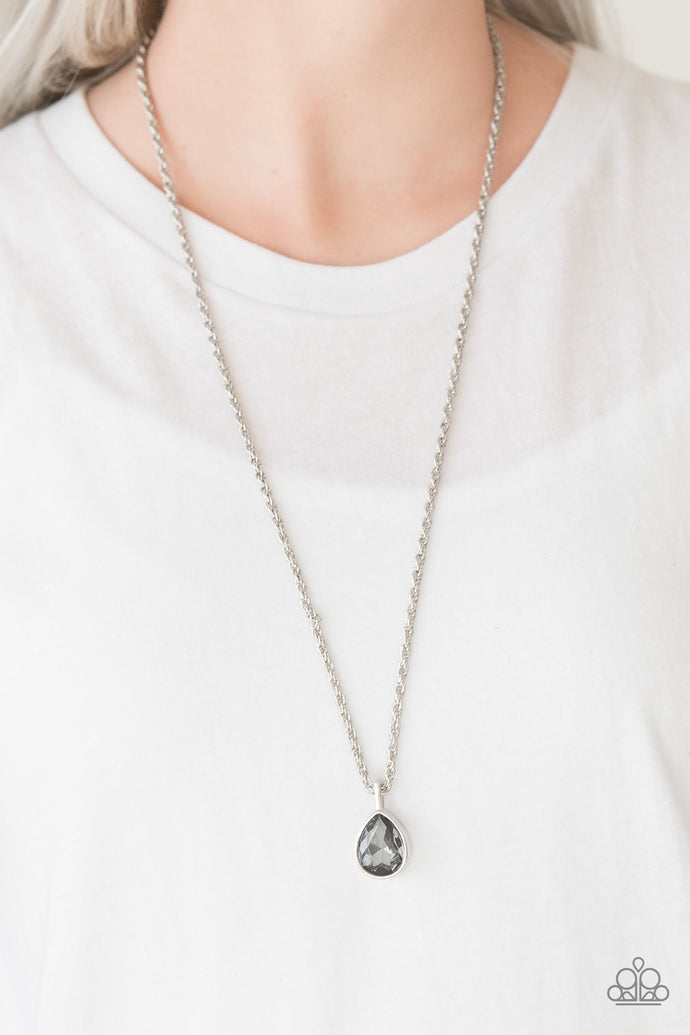 A smoky teardrop gem is pressed into a sleek silver frame, creating a bold 3-dimensional pendant below the collar. Features an adjustable clasp closure.  Sold as one individual necklace. Includes one pair of matching earrings.  Always nickel and lead free.