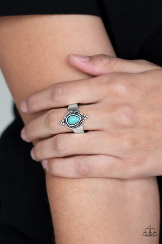 Chiseled into a tranquil teardrop, a refreshing turquoise stone is pressed into the center of a dainty silver band for a seasonal look. Features a dainty silver band for a flexible fit.   Sold as one individual ring.
