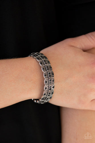 Encrusted in glittery black rhinestones, ornately studded silver frames are threaded along stretchy bands for an edgy-glamorous look.  Sold as one individual bracelet.  Always nickel and lead free.