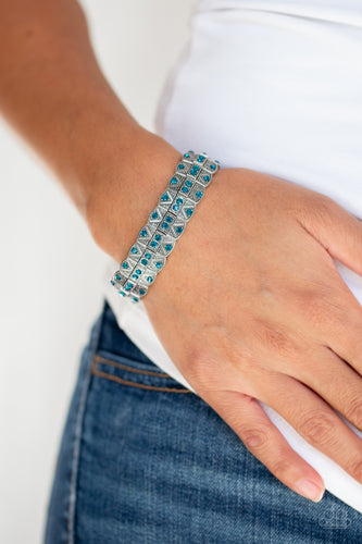 Encrusted in glittery blue rhinestones, ornately studded silver frames are threaded along stretchy bands for an edgy-glamorous look.  Sold as one individual bracelet.   Always nickel and lead free.