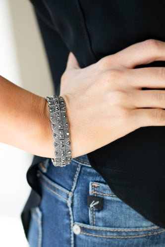 Encrusted in glittery hematite rhinestones, ornately studded silver frames are threaded along stretchy bands for an edgy-glamorous look.  Sold as one individual bracelet.  Always nickel and lead free.