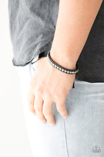 Black twine and shiny black cording knots around ornate silver beads for a nautical inspired fashion. Features an adjustable sliding knot closure.  Sold as one individual bracelet.  always nickel and lead free