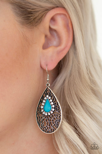 Ringed in glassy white rhinestones, a teardrop blue bead is pressed into a shimmery silver frame radiating with airy filigree for a refined fashion. Earring attaches to a standard fishhook fitting.  Sold as one pair of earrings. Always nickel and lead free.