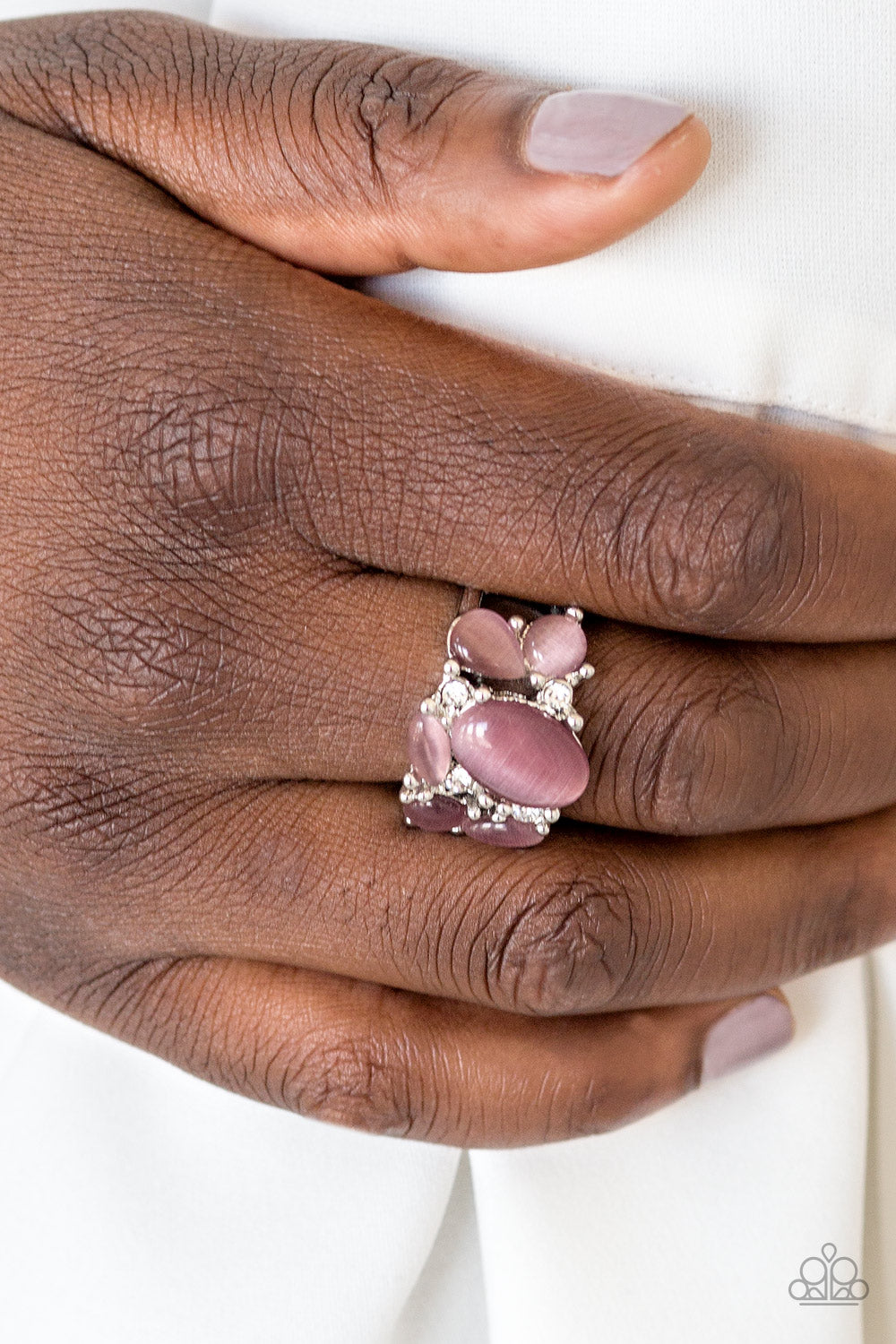 Glittery white rhinestones and glowing purple moonstones are sprinkled across the finger, coalescing into a whimsical band. Features a stretchy band for a flexible fit.  Sold as one individual ring.  Always nickel and lead free.