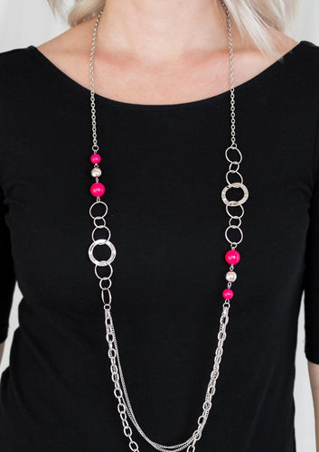 Vivacious pink beads, shiny silver beads, and glistening silver hoops give way to mismatched silver chains for a whimsical look. Features an adjustable clasp closure.  Sold as one individual necklace. Includes one pair of matching earrings.  Always nickel and lead free.  Fashion Fix Exclusive March 2021