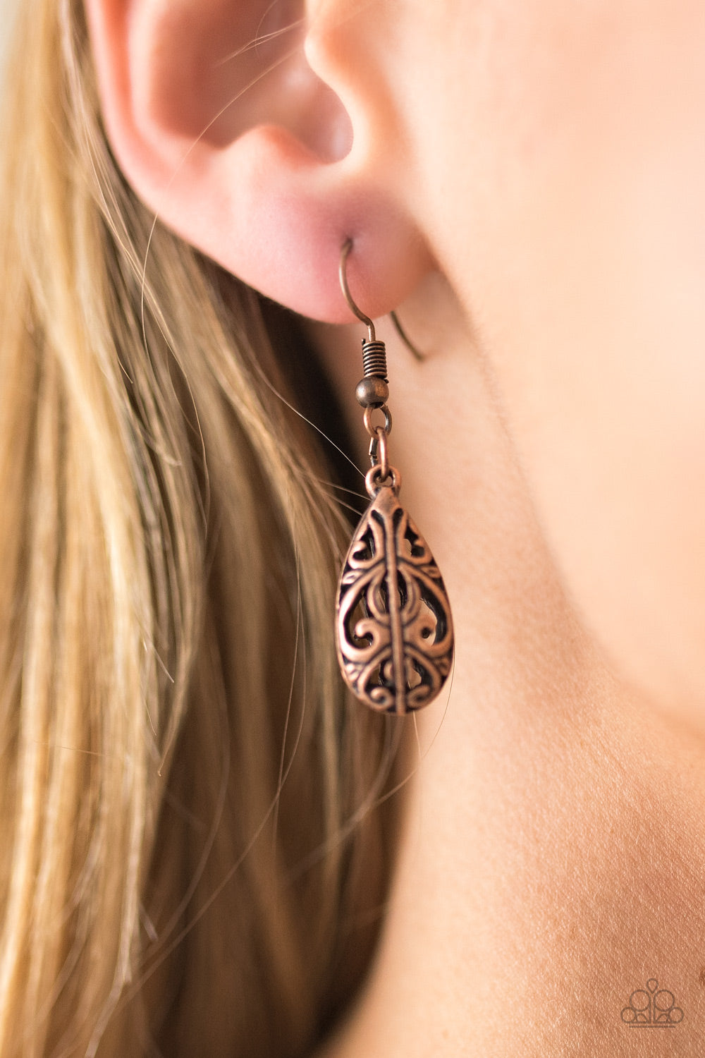 Featuring an airy 3-dimensonal frame, an airy filigree filled teardrop swings from the ear in a casual fashion. Earring attaches to a standard fishhook fitting.  Sold as one pair of earrings.  Always nickel and lead free.