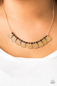 Embossed in wavy textures, shimmery gold plates swing from the bottom of a strand of dainty black beading, creating a colorful fringe below the collar. Features an adjustable clasp closure.  Sold as one individual necklace. Includes one pair of matching earrings.   Always nickel and lead free.