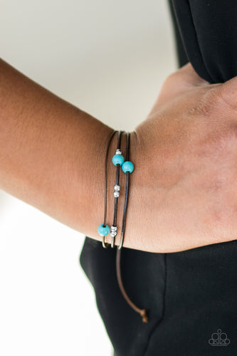 Shiny silver beads and refreshing turquoise stones are threaded along shiny black cording, creating dainty layers across the wrist. Features an adjustable sliding knot closure.  Sold as one individual bracelet.  Always nickel and lead free.